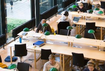 Students studying in a library reading room