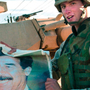 US soldier with picture of Saddam