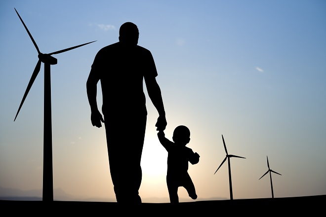Man with child before windmills