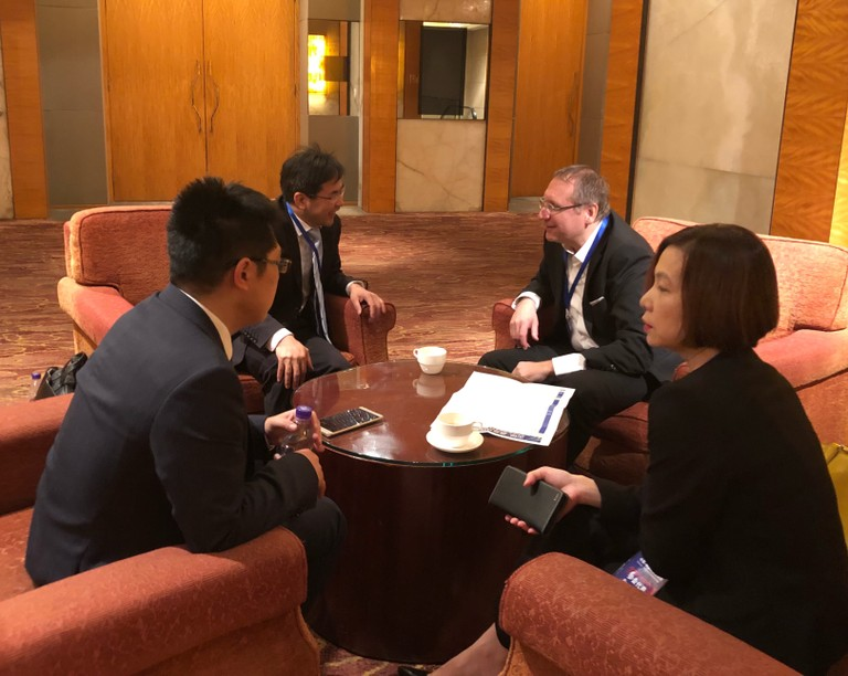IFE partners in discussion. Dr. Xinyu Zhang from Jinko Solar (left), Prof. Xiaolong Du from CAS (second left), Prof. Andrej Kuznetsov from UiO (second right) and Ivy Liu from Compart As (right).