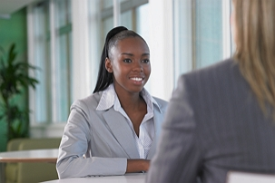 Young woman in formal talk with her manager