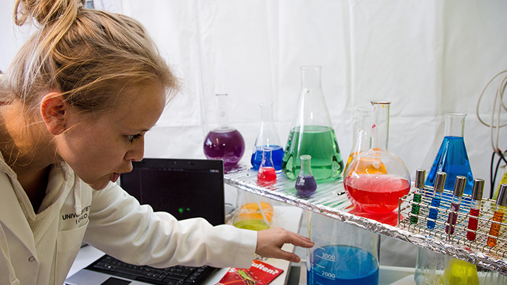 Researcher showing kids a chemical reaction
