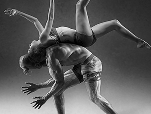 Two athletic dancers. Black and white. Photo.