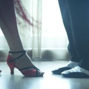 High heels and nice shoes. A man and woman pictured from the knees down. Photo.