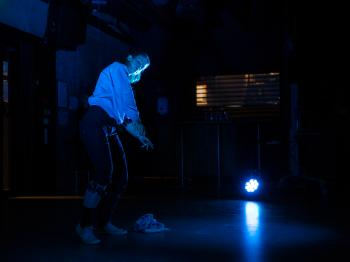Blue ,Light ,Darkness ,Standing ,Performance.