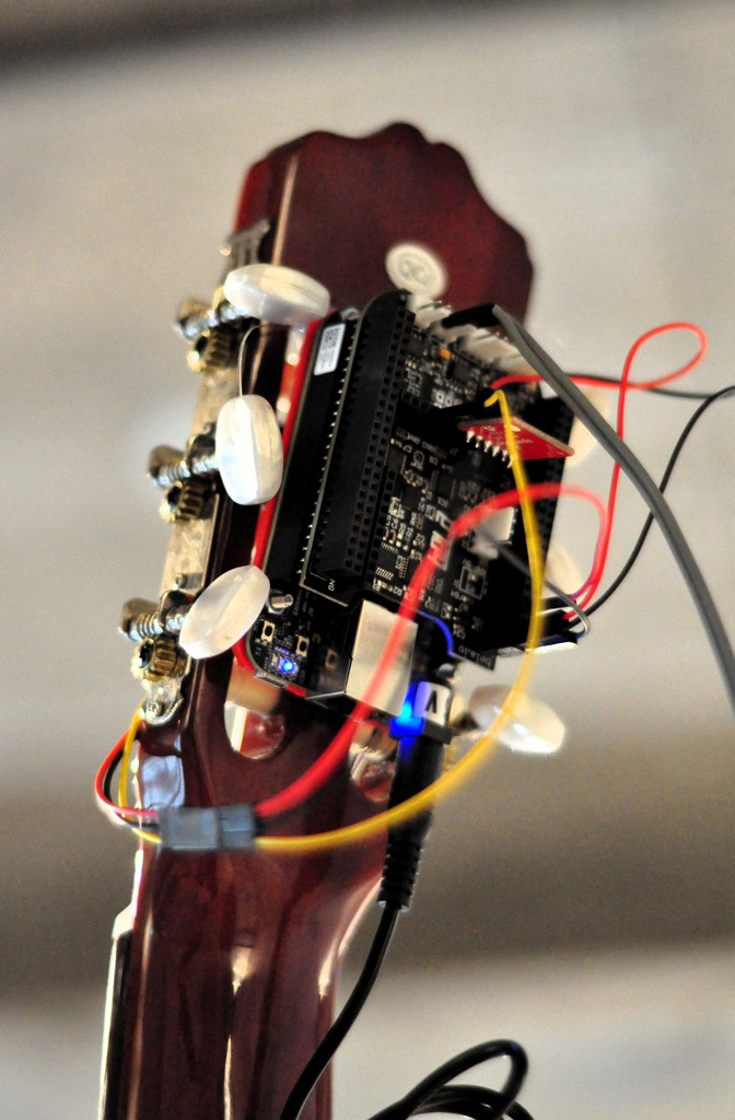 Guitar with micro-computer